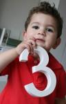 Joey holds a number 3 Bev Dunbar Maths Matters