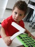 Joey holds number 7 Bev Dunbar Maths Matters