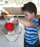 Joey measures water Bev Dunbar Maths Matters