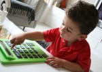 Joey uses his calculator to count Bev Dunbar Maths Matters